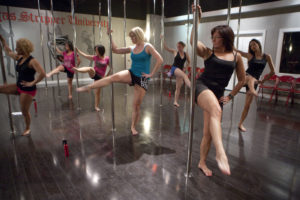 Students follow their pole dancing instr